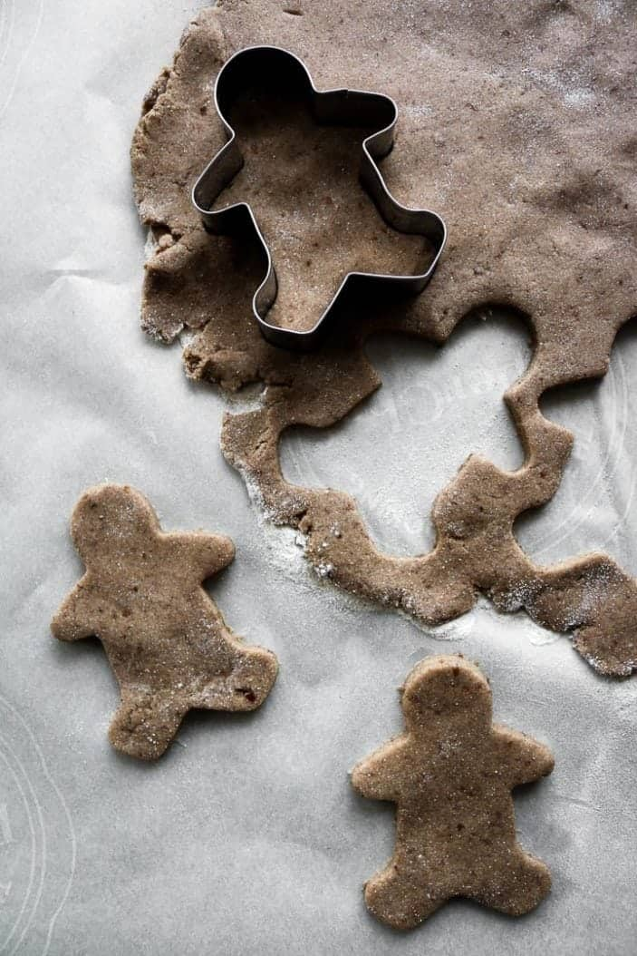 Chai-Spiced Cut-Out Cookies being made into gingerbread men seen from the top with the cut-out.