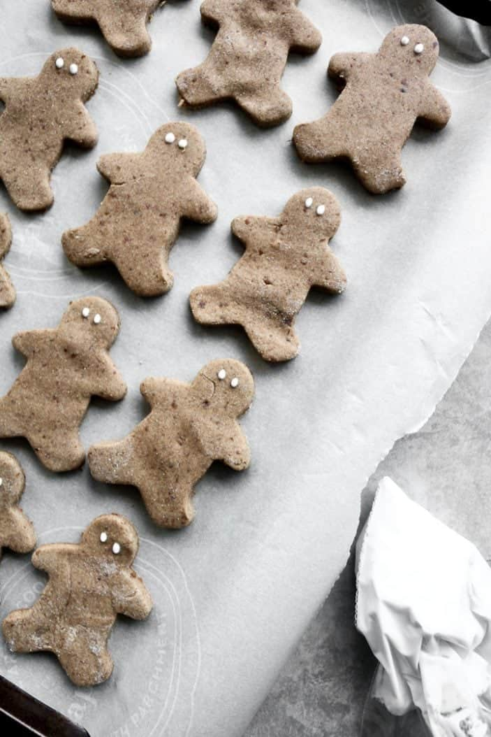 Chai-Spiced Cut-Out Cookies seen from the top as gingerbread men with little dots as eyes.