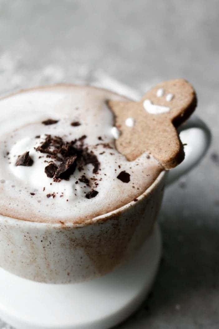 Creamy Sugar-Free Hot Chocolate seen from the side with a gingerbread man in the cup.