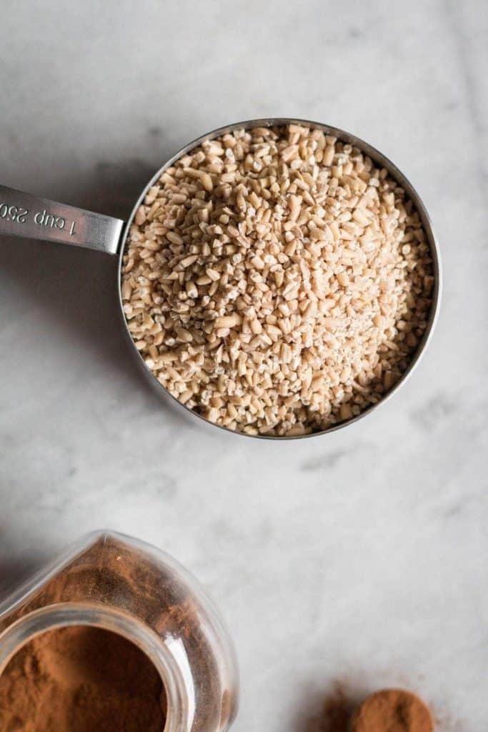 steel-cut oats in a measuring cup
