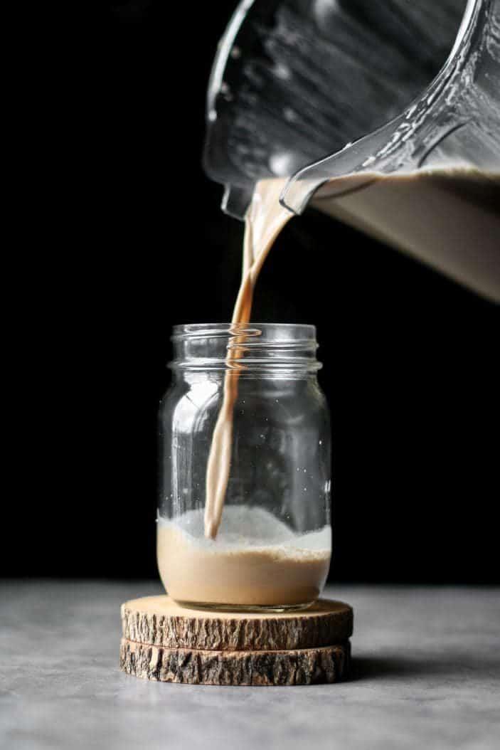 Creamy Cashew Chai Latte poured in jar