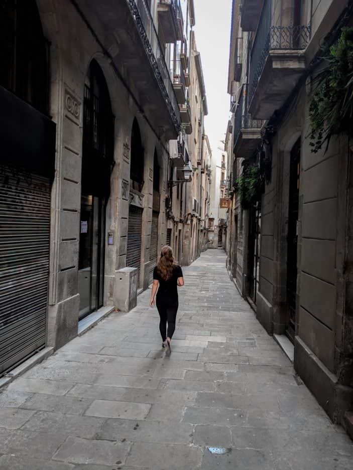 How to Stay Healthy While Traveling - girl walking in Barcelona