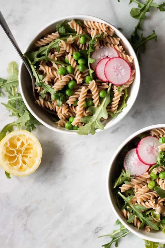 arugula pasta salad in a bowl