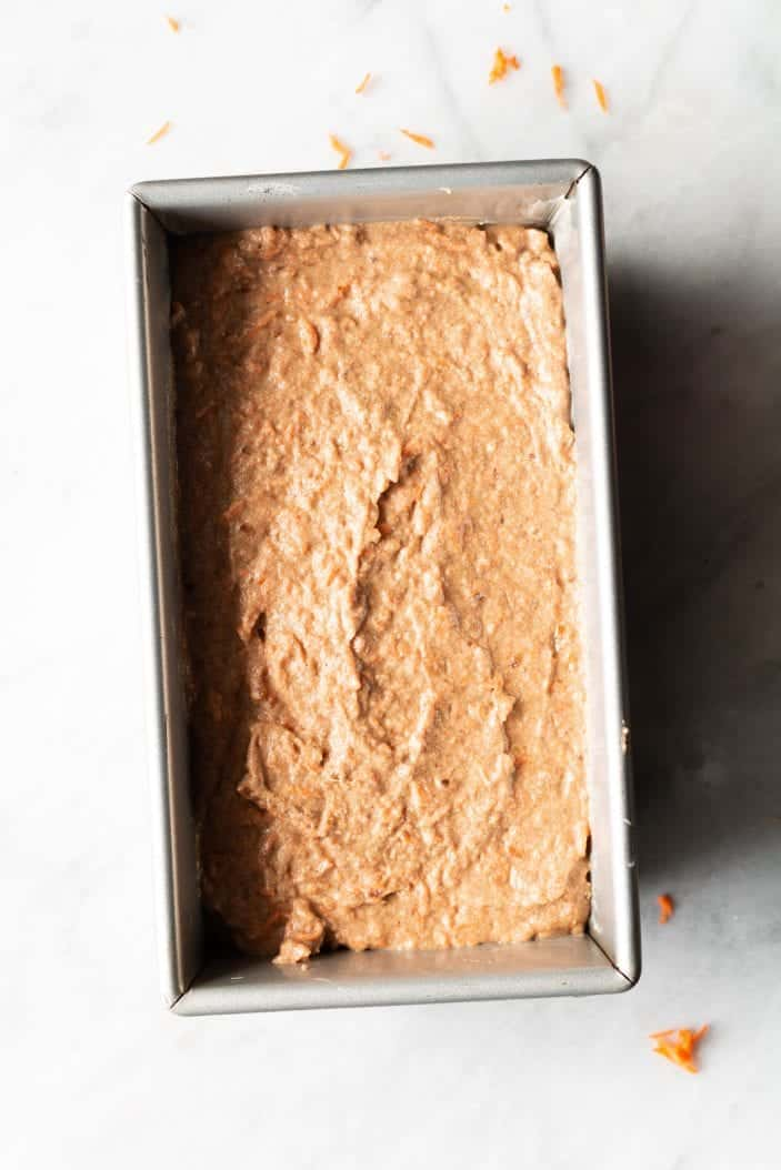 unbaked carrot cake in a loaf pan