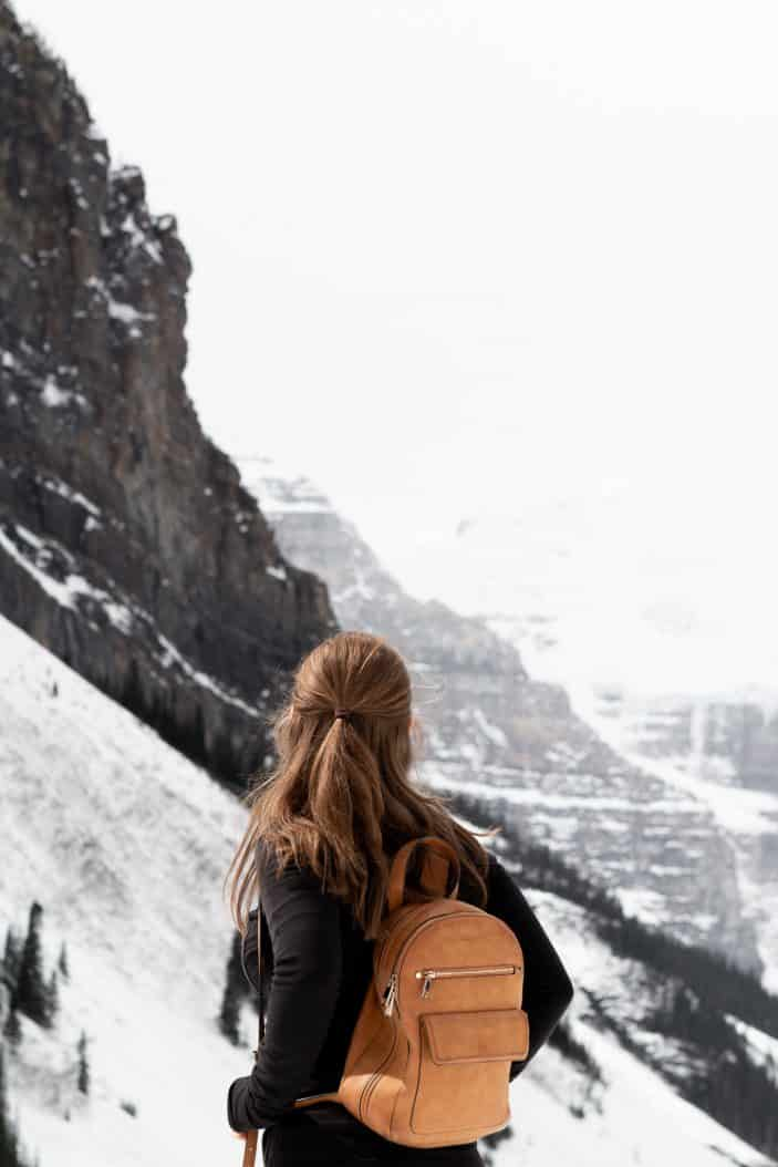 girl surrounded by mountains