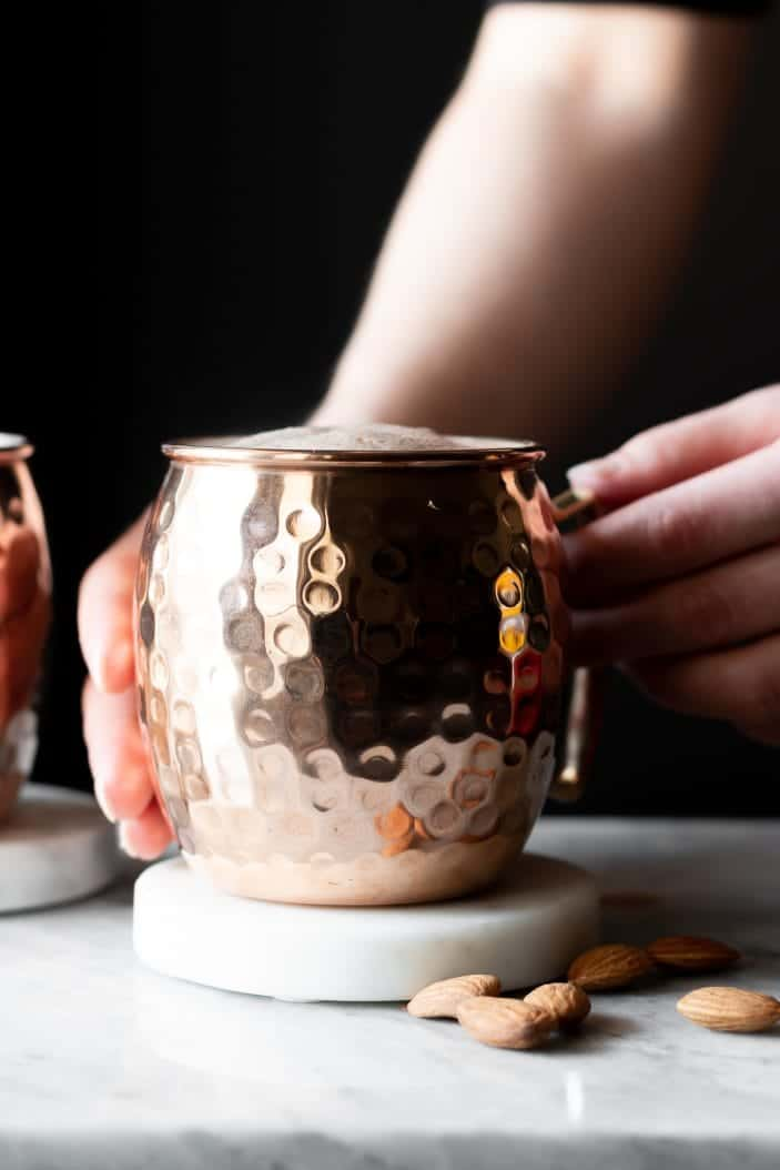 hands holding hot cocoa mug