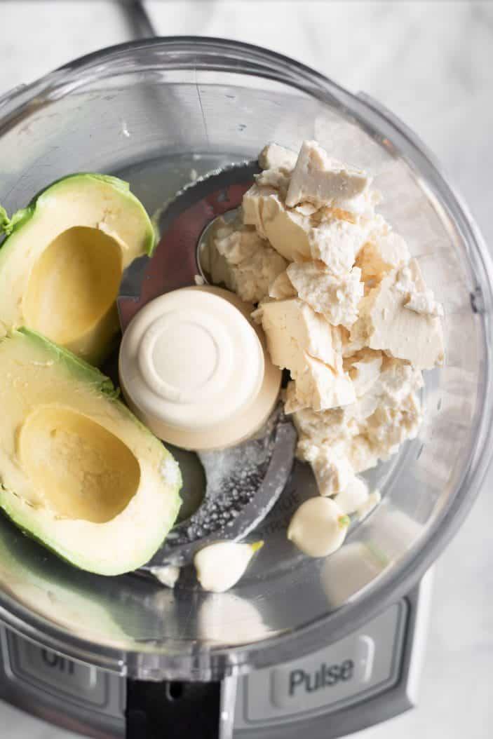 tofu, avocado and garlic in a food processor