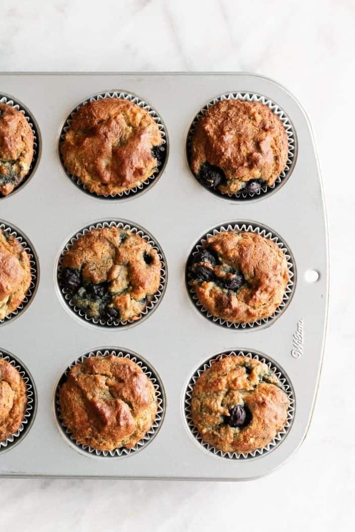 blueberry banana almond flour muffins baked in pan