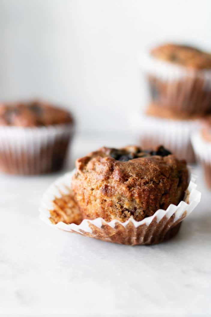 blueberry banana almond flour muffins in muffin liner