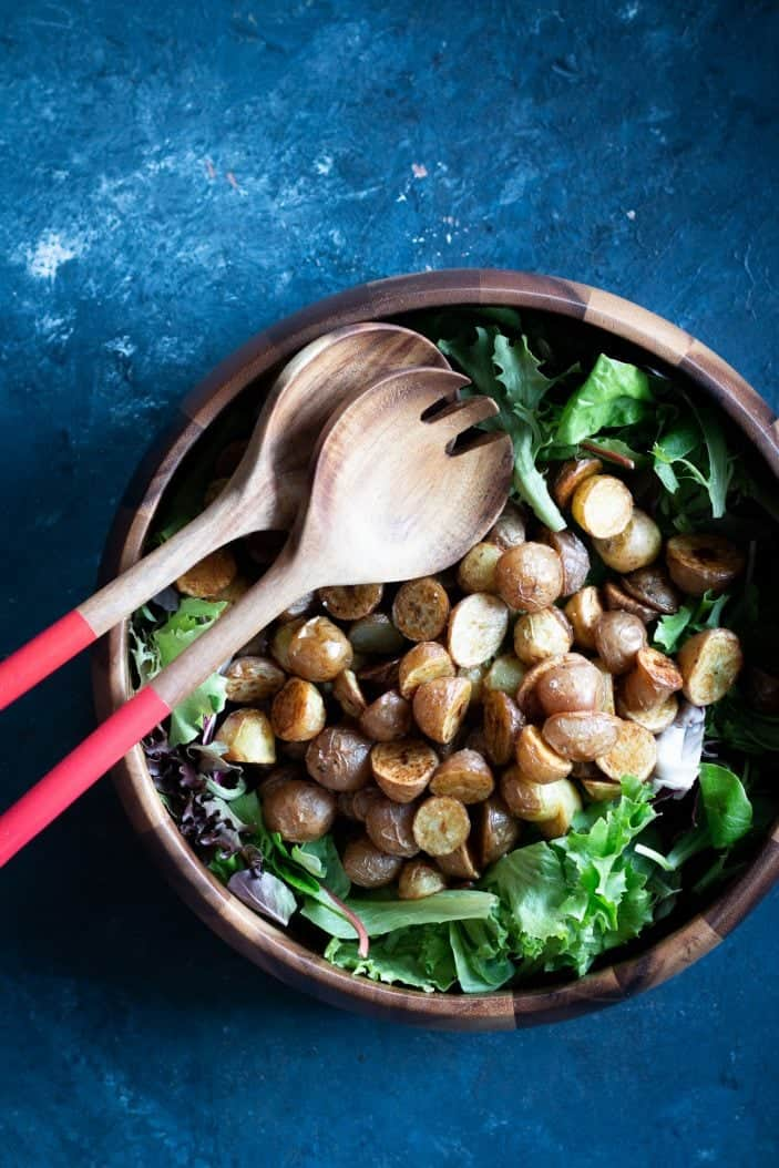 Roasted Potatoes and leafy greens in a bowl