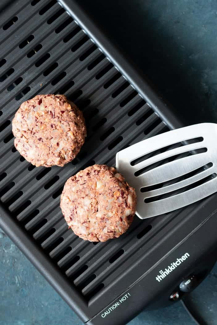 grillable walnut veggie burger on a grill