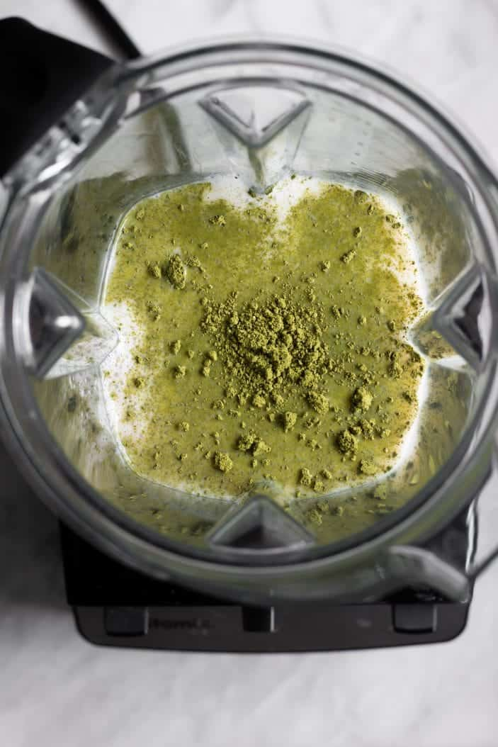 matcha and milk in a blender