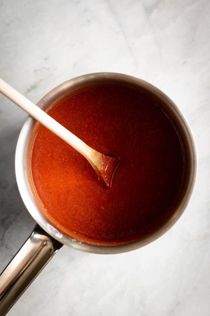enchilada sauce in saucepan
