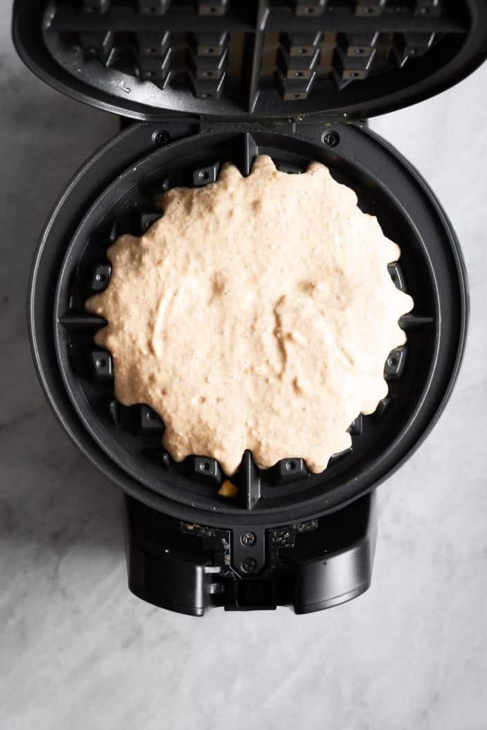 Pumpkin Chai Spiced Waffles in waffle iron