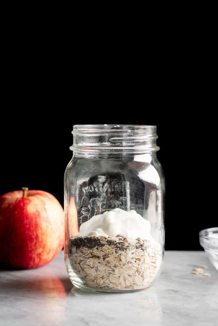 Protein Apple Muesli ingredients in a jar from the side