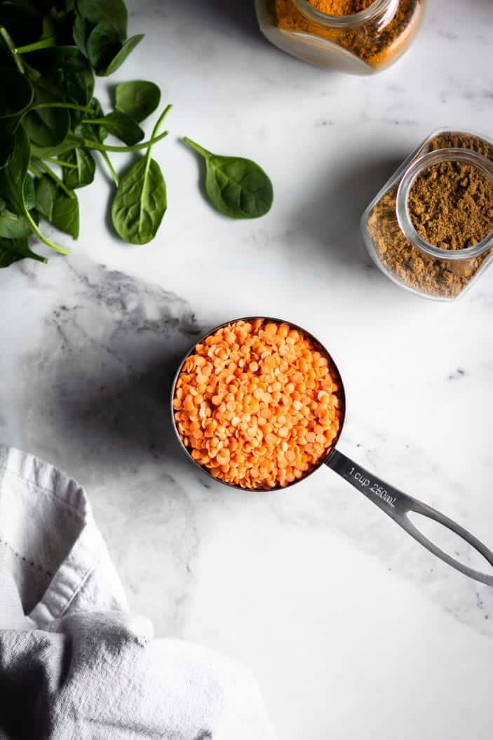 red lentils in measuring cup