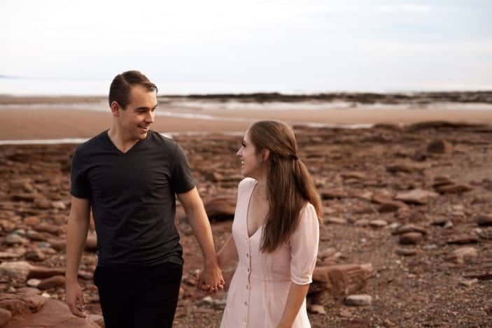 couple holding hands laughing - engagement photos