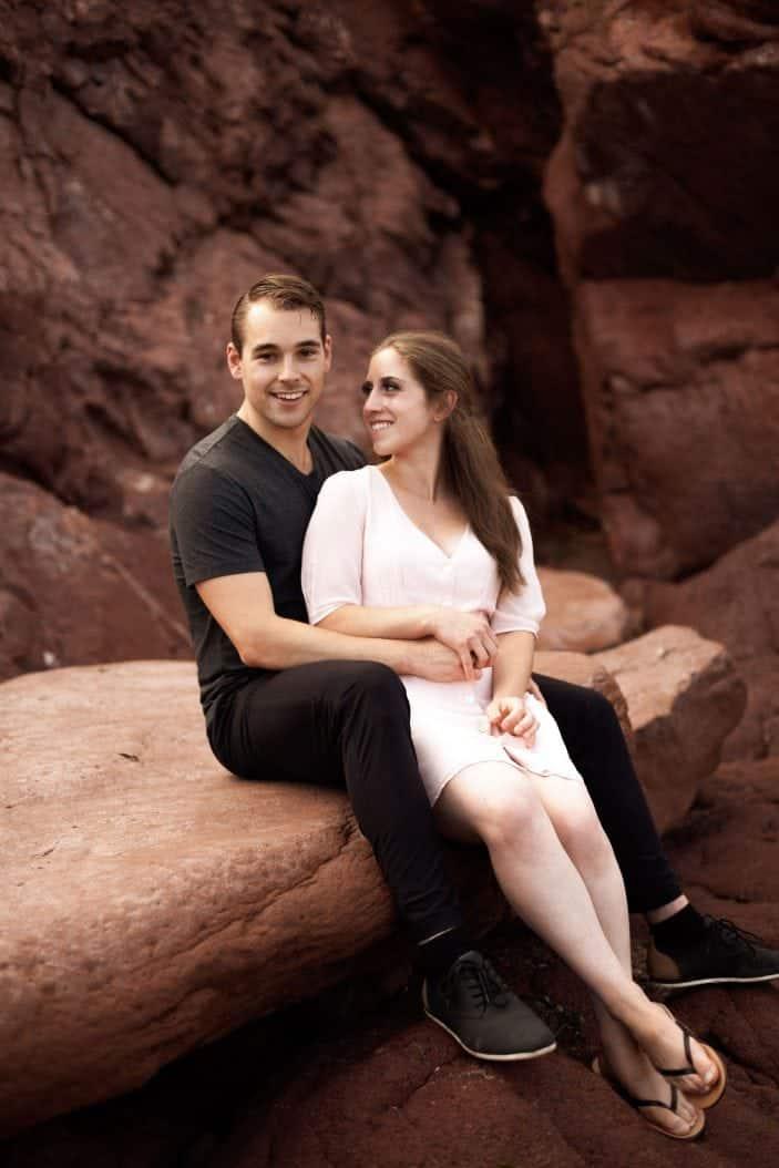 couple sitting on rock
