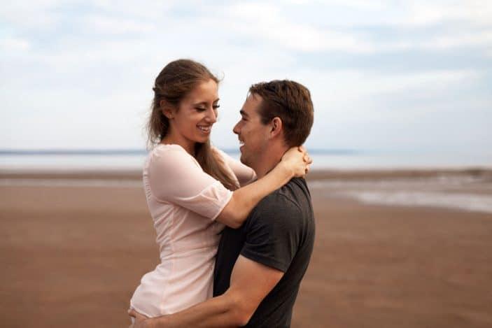 guy holding girl, laughing