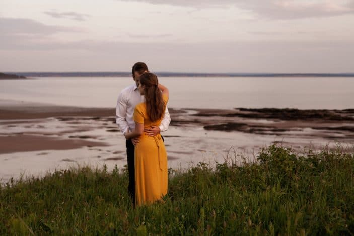 couple hugging in tall grass