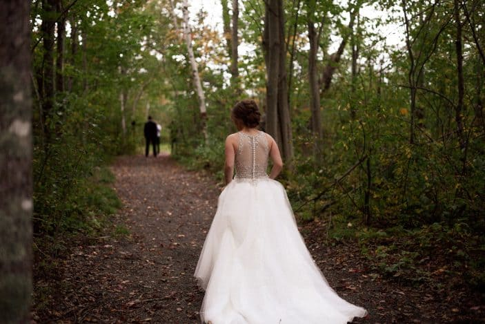 Our rustic chic and cozy fall wedding - bride walking in the forest