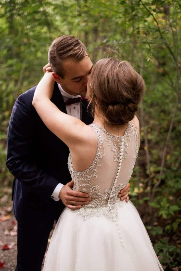 Our rustic chic and cozy fall wedding - bride and groom kissing