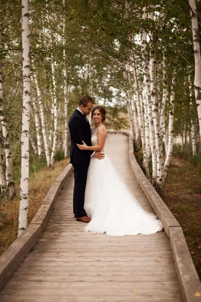 bride and groom holding each other - cozy fall wedding