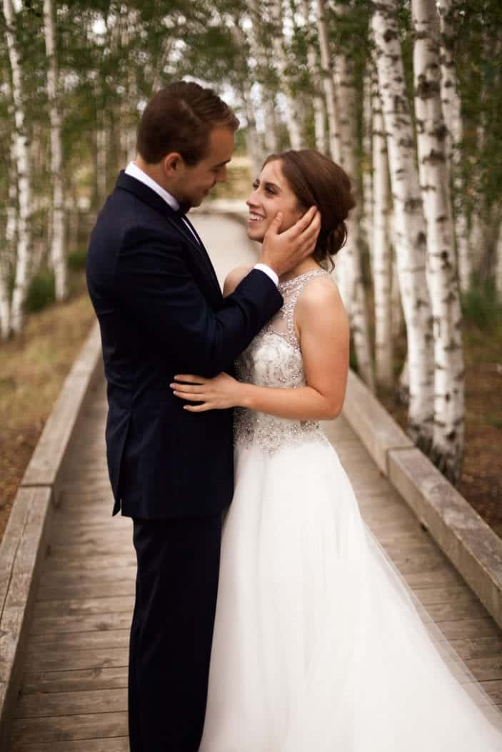 bride and groom looking at each other - cozy fall wedding
