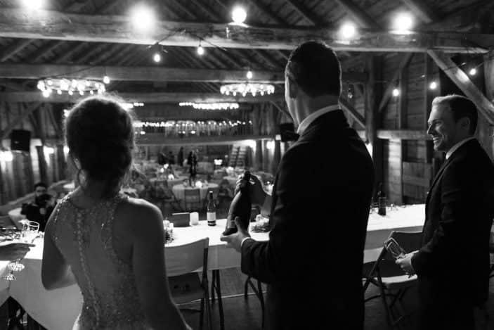 bride and groom overlooking the barn interior