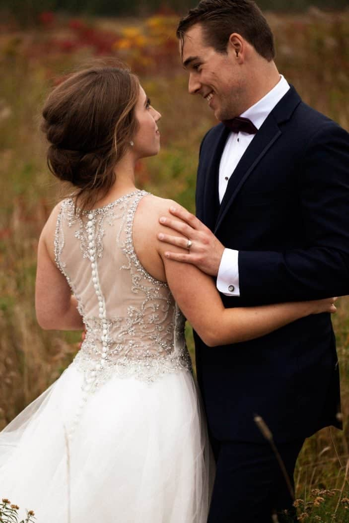 bride and groom smiling at eachother - wedding photos