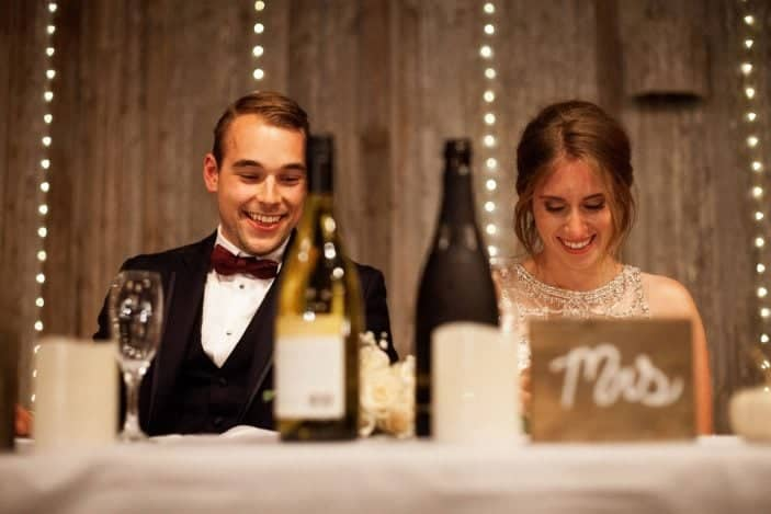 bride and groom sitting beside eachother
