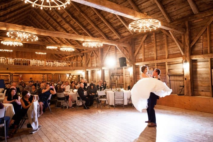 groom holding bride during first dance