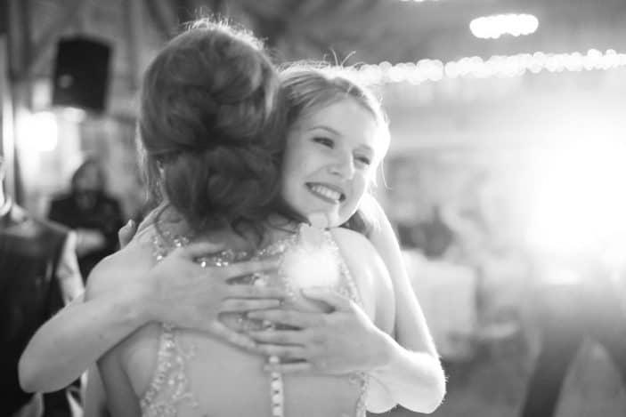 bride and bridesmaid huging