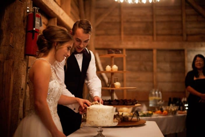 bride and groom cutting the cake