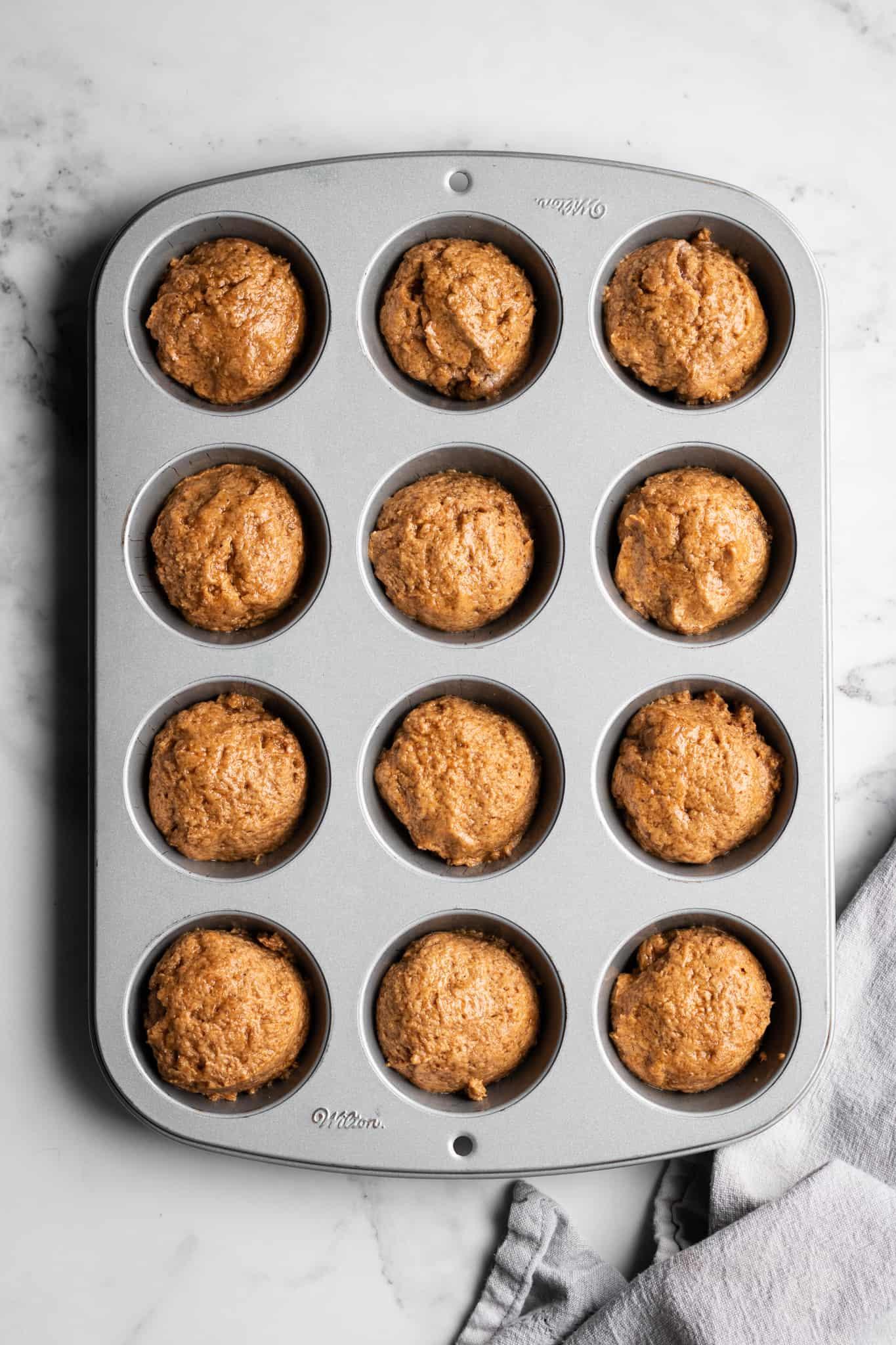 wet muffin mixture in muffin tins