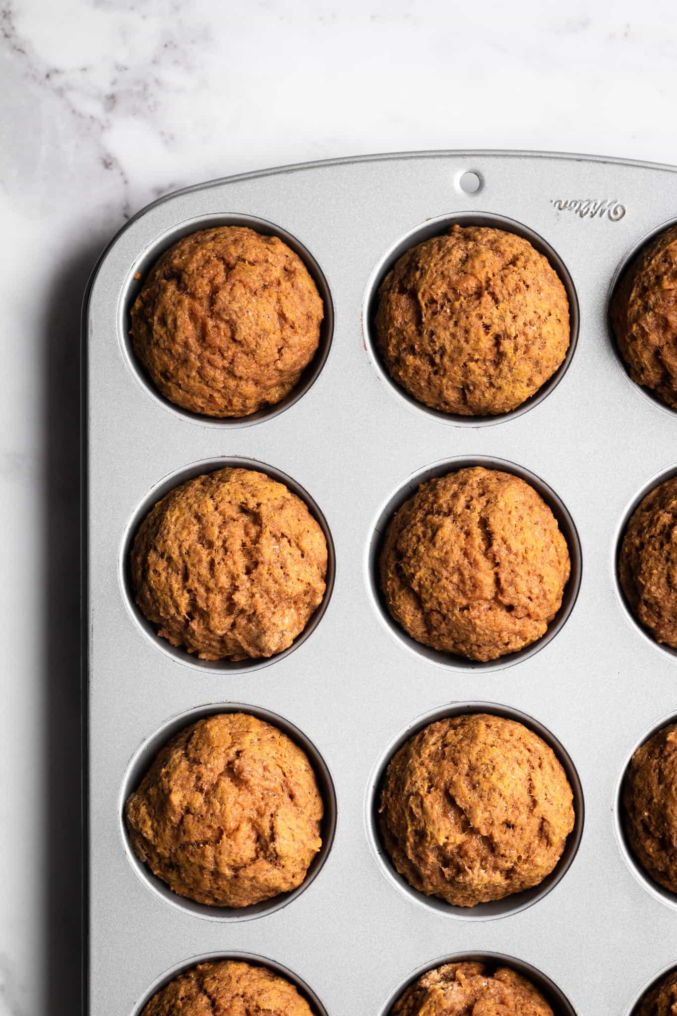 cooked pumpkin muffins in muffin tin